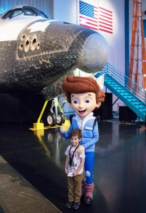Jet Propulsion gives a thumbs up with a new friend at Space Center Houston.